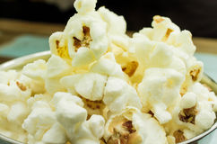 Cropped Popcorn in a silver bowl over wood background Stock Photo