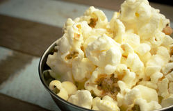 Cropped Popcorn in a silver bowl over wood background Stock Images