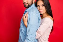 Cropped portrait, half face of man with bristle, woman embracing. Cropped portrait, half face of men with bristle, women embracing his lover from back with Stock Image