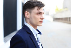 Cropped portrait of a handsome businessman standing outside. Stock Photo