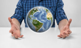 Cropped portrait of a man holding Earth in his hands. Royalty Free Stock Image
