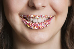 Cropped portrait of Middle Eastern woman with sprinkle candy lips Royalty Free Stock Photography