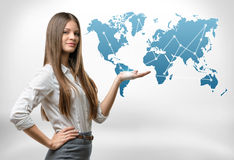 Cropped portrait of young businesswoman raised her hand presenting world map. Global communication. International relations. Business staff royalty free stock photos