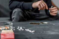 cropped shot of addicted man stock photo