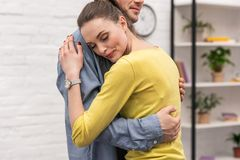 Cropped shot of adult couple embracing. At home stock images