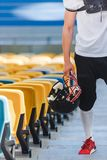 Cropped shot of american football player standing on stairs. At sports stadium Stock Images