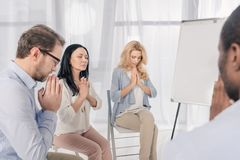 cropped shot of anonymous group of multiethnic people praying during royalty free stock images