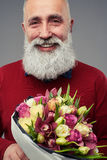 Cropped shot of bearded man with a bouquet of tulips Royalty Free Stock Photography
