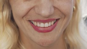 Cropped shot of a beautiful unrecognizable woman smiling. Happy mature female smiling cheerfully, showing off her healthy white teeth. Dentistry, health stock video footage