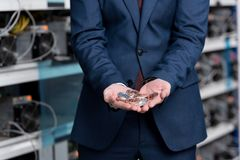 cropped shot of businessman with heap of bitcoins in hands at cryptocurrency Royalty Free Stock Photo