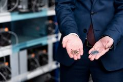 cropped shot of businessman holding bitcoins at cryptocurrency Stock Images