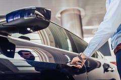 Businessman opening car door stock photography