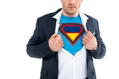cropped shot of businessman showing superhero costume under suit stock images