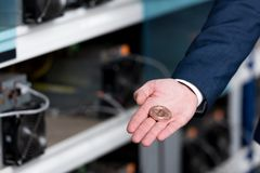 cropped shot of businessman in suit holding bitcoin at cryptocurrency Royalty Free Stock Images