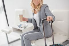 Businesswoman with suitcase and coffee to go Royalty Free Stock Photo
