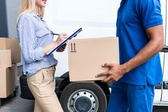 Courier delivering packages for woman Stock Photos