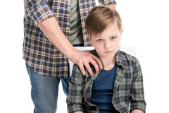 Cropped shot of father putting hand on shoulder of upset little son. Family problems concept Stock Photo