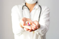 Cropped shot of a female doctor displaying a handful of tablets and pills in her palm Stock Images