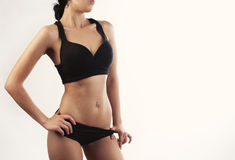 Cropped shot of fit woman's torso with her hands on hips Stock Photography