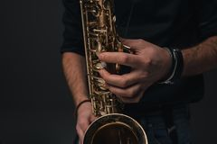 Cropped shot of jazz musician. Playing saxophone Stock Photo
