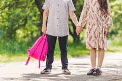 Cropped shot of kids holding hands while spending time together. In park royalty free stock images