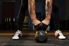 Cropped shot of male hands holding kettlebell. royalty free stock photos