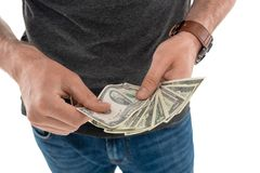 Cropped shot of man counting money in hands. Isolated on white royalty free stock images