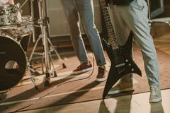 Cropped shot of musicians with instruments. At studio stock photo