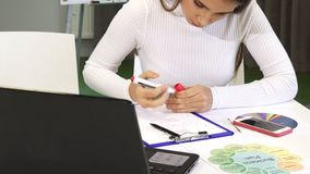 Free Cropped Shot Of A Young Business Woman Writing Notes At The Office Royalty Free Stock Photos - 128829548