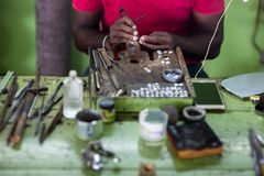 Jeweler making rings stock photo