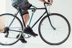 cropped shot of paralympic man with leg prosthesis on bicycle stock photos