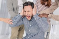 Cropped shot of people supporting depressed middle aged man. Screaming during group therapy Stock Photos