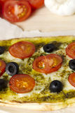 Cropped shot of a pizza with vegetables toppings Stock Photo