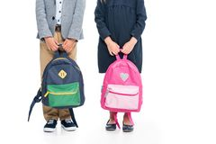 Pupils. Cropped shot of pupils with backpacks isolated on white Royalty Free Stock Photos
