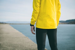 Cropped shot of runner standing on river dock.  Stock Photo