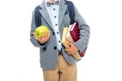 Schoolboy. Cropped shot of schoolboy with books and apple isolated on white Royalty Free Stock Image