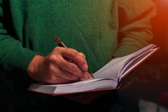 Cropped shot of senior man writing in a diary. Closeup Royalty Free Stock Photography