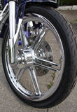 Cropped shot of the shot of the motorcycle forks. Tire and front wheel Royalty Free Stock Photos
