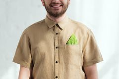 Cropped shot of smiling man. With savoy cabbage leaf in pocket vegan lifestyle concept royalty free stock photos