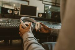 Cropped shot of sound producer with headphones sitting. At studio Royalty Free Stock Image