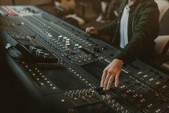 Cropped shot of sound producer working. With recording equipment royalty free stock photography