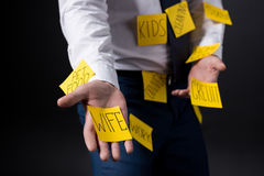 Cropped shot of stressed businessman with sticky notes on clothes standing Royalty Free Stock Photography