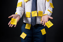 Cropped shot of stressed businessman with sticky notes on clothes standing Royalty Free Stock Photo