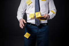 Cropped shot of stressed businessman with sticky notes on clothes standing Royalty Free Stock Image