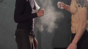 Cropped shot of two athletic men bumping fists at the gym. Cropped close up of two strong athletic men bumping fists after working out together at the gym stock video