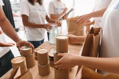 Volunteers sorting tin cans with food. Cropped shot of volunteers sorting tin cans with food for charity Royalty Free Stock Photos