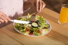Woman eating fresh salad stock image