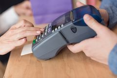cropped shot of woman making payment with credit card royalty free stock image