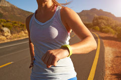 Cropped shot of woman running Stock Images