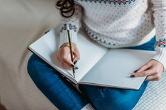 Woman writing in notebook Stock Images